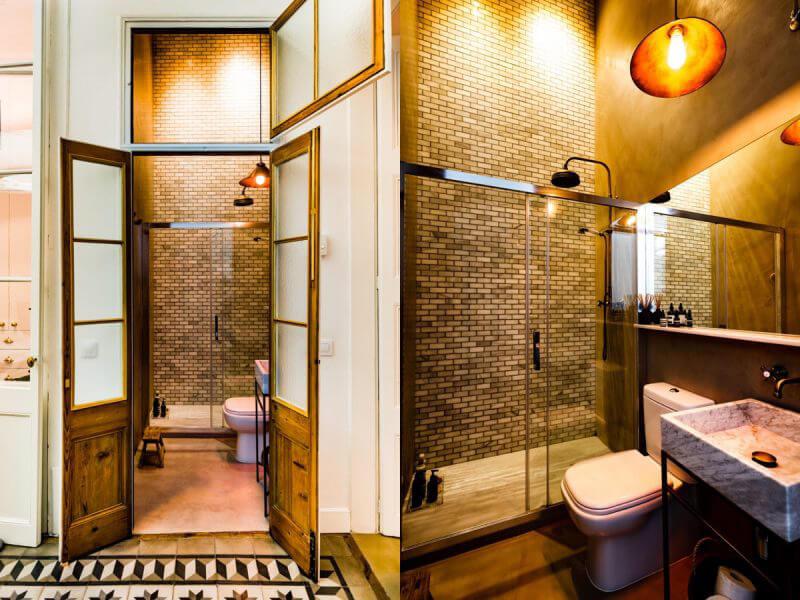 không gian nhà tắm mang hơi hướng cổ điển với gam màu vàng sang trọng